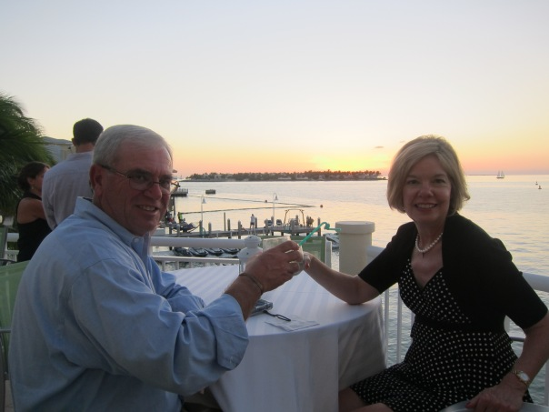 Mom and Dad toasting to how nice their life is.